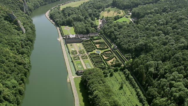 stockvideo's en b-roll-footage met ms aerial zi ds view of freyr castle and gardens (tatty) near river / walloon region, belgium - kasteel