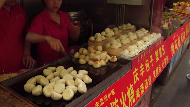 view of fried dumplings in famous wangfujing snack street on may 4, 2017 in beijing, china. wangfujing is a main business street for tourism next to... - prosperity stock videos & royalty-free footage