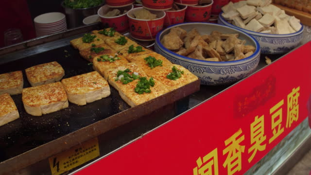 A view of fried tofu in famous Wangfujing Snack Street on May 4 2017 in Beijing China Wangfujing is a main business street for tourism next to the...