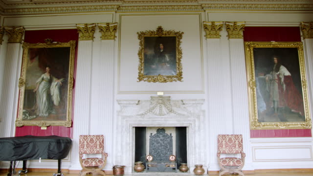 MS TD View of from chandelier to fireplace with Earl of Manchester portrait at Kimbolton School / Cambridgeshire, United Kingdom