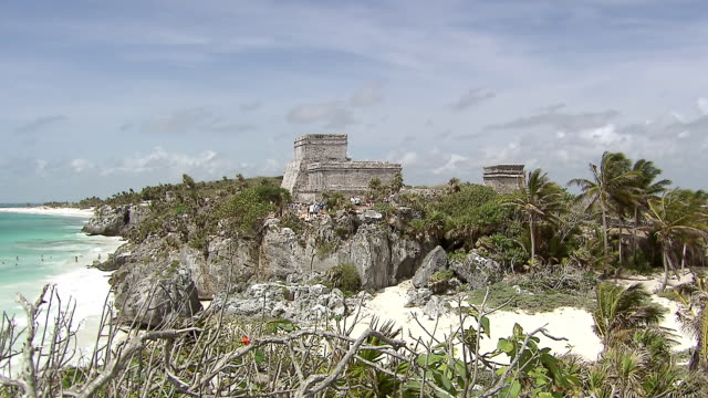 ws pan view of from pyramid el castillo (the castle), out tocaribbean sea with small fishing boats / tulum, quintana roo, mexico - quintana roo stock videos and b-roll footage