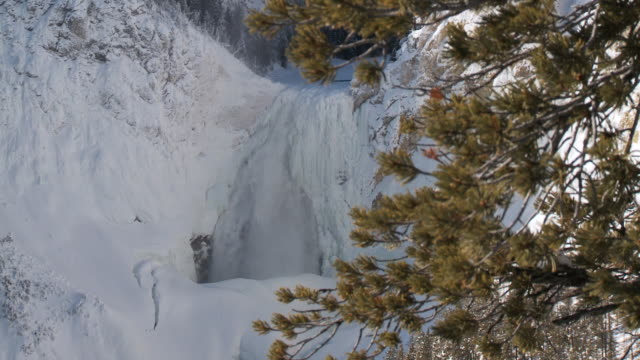 ws td view of frozen yellowstone lower falls waterfall / yellowstone national park, wyoming, united  - lower yellowstone falls stock videos & royalty-free footage