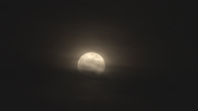 ws view of full moon behind clouds / orem, utah, usa - orem stock-videos und b-roll-filmmaterial