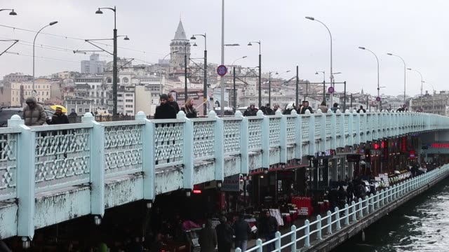 view of galata bridge in istanbul turkey istanbul sightseeing on march 16 2013 in istanbul turkey - yeni cami mosque stock videos and b-roll footage