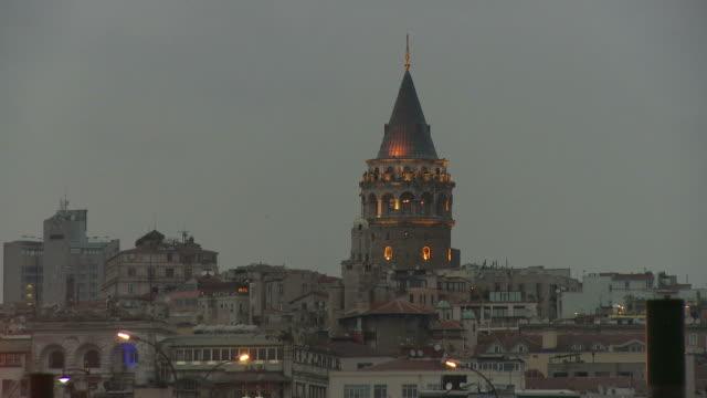 view of galata tower in istanbul turkey - galataturm stock-videos und b-roll-filmmaterial