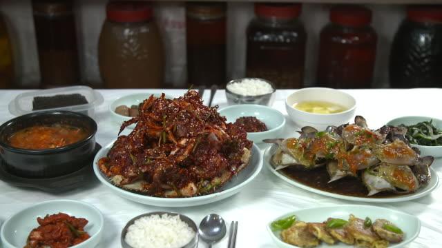 view of ganjang gejang(soy sauce marinated raw crab) and yangnyeom gejang(seasoned marinated raw crab) - marinated stock videos and b-roll footage