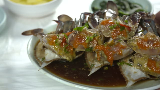 view of ganjang gejang(soy sauce marinated raw crab) laying on the table - marinated stock videos and b-roll footage
