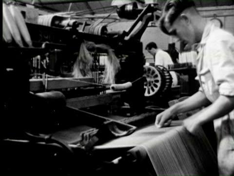 b/w view of garment industry, england / audio - 製造工場点の映像素材/bロール