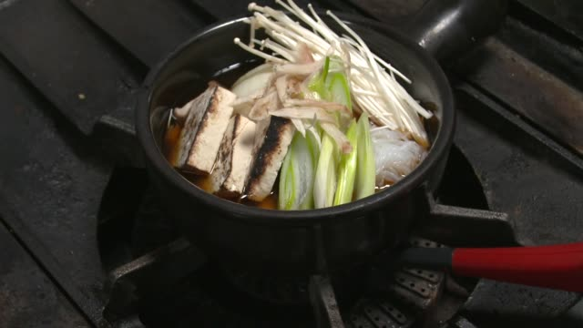 View of gas burner igniting on a stove hob to make Sukiyaki(Japanese dish that prepared and served in the Japanese hot pot style)