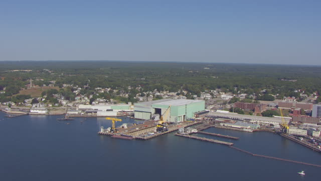 WS AERIAL POV View of General Dynamics Electric Boat in warehouse / Groton, Connecticut, United States