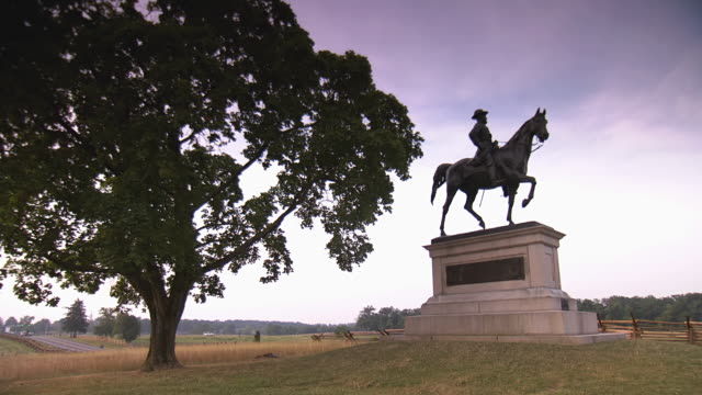 ws pan la view of general hancock monument at gettysburg national military park with wooden fence and highway in back side / gettysburg, virginia, united states - gettysburg stock videos & royalty-free footage