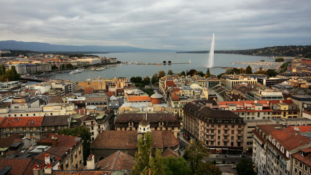T/L WS HA View of Geneva city and lake Geneva with Jet d'Eau, day to night, Geneva, Switzerland