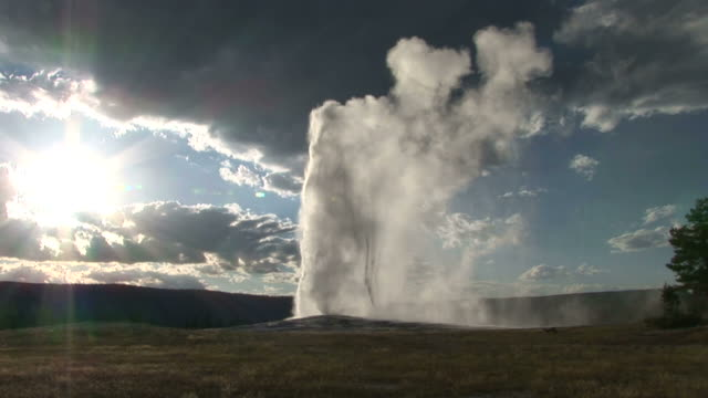view of geyser in yellowstone national park in wyoming united state - geyser stock videos & royalty-free footage
