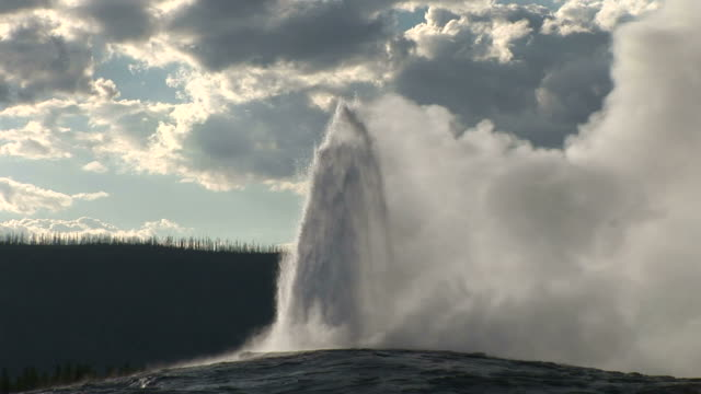 view of geyser in yellowstone national park in wyoming united state - geyser video stock e b–roll