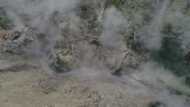 view of geyser valley stream steaming in kamchatka, russia - steep stock videos & royalty-free footage