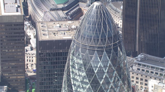 ws zi ds aerial view of gherkin building / london, united kingdom  - sir norman foster building stock videos & royalty-free footage