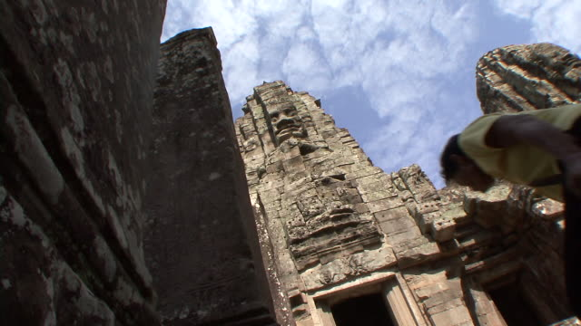 ms view of giant head of bodhisattva lokeshvara / siem reap, cambodia - cambodian culture stock videos and b-roll footage