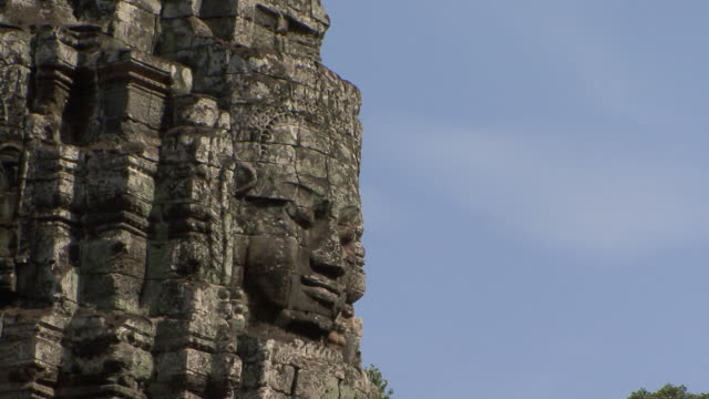ws zo view of giant head of bodhisattva lokeshvara / siem reap, cambodia - cambodian culture stock videos and b-roll footage