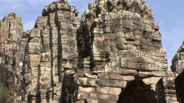 ms view of giant heads of bodhisattva lokeshvara / siem reap, cambodia  - cambodian culture stock videos and b-roll footage