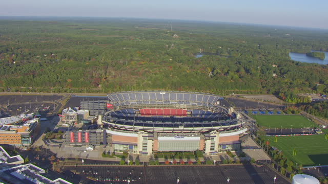 WS AERIAL POV View of Gillette Stadium with landscape / Foxborough, Massachusetts, United States