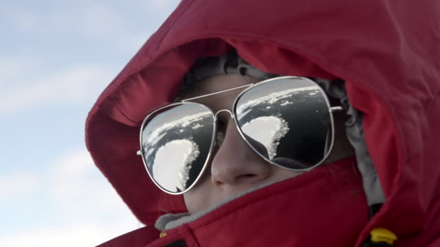 CU View of girl wearing sunglasses with reflection on it / Weddell Sea, Antarctica