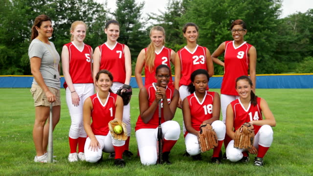 ws view of girls softball team with coach / albany, new york, united states  - crouching stock videos and b-roll footage