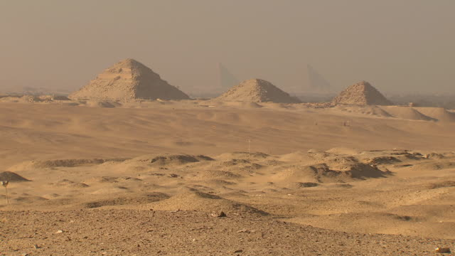 ws view of giza pyramids and sandy landscape from saqqara / egypt - saqqara stock videos and b-roll footage