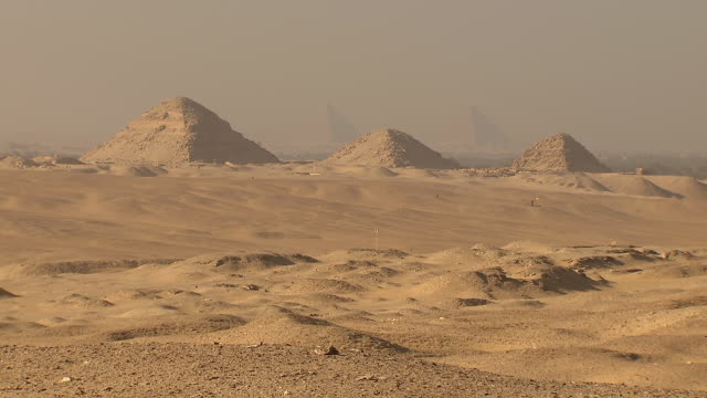 WS ZI View of Giza pyramids and sandy landscape from Saqqara / Egypt