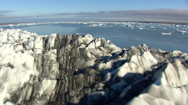 WS AERIAL View of glacier and Jokulsarlon icebergs / Iceland