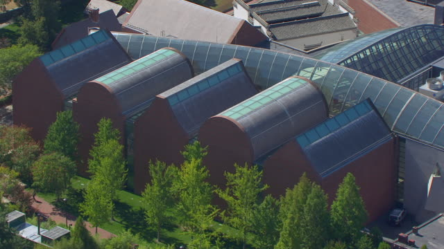 ms aerial pov view of glass atrium rooftop peabody essex museum and yin yu tang chinese house / salem, massachusetts, united states - salem stock videos & royalty-free footage