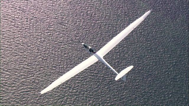 ws aerial  ts zo zi view of glider  / grube, schleswig-holstein, germany - gliding stock videos and b-roll footage