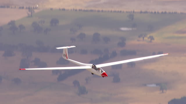 ws aerial zi zo ts view of glider plane / macarthur, victoria, australia - glider stock videos & royalty-free footage