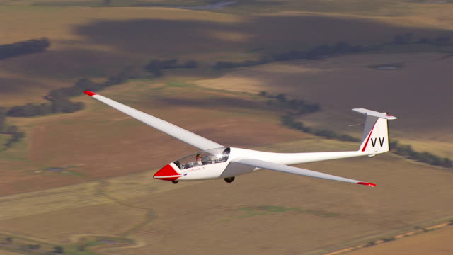 ms aerial ts view of glider plane / macarthur, victoria, australia - gliding stock videos and b-roll footage
