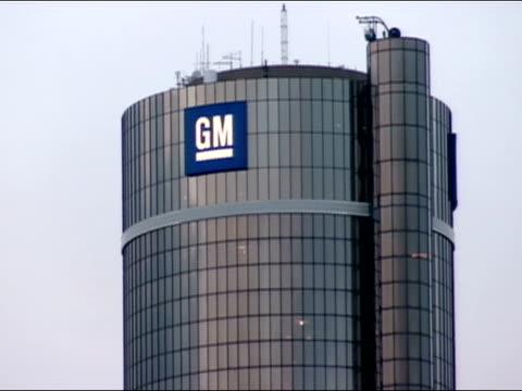 view of gm sign on detroit marriott at the renaissance center / detroit, michigan - gm stock-videos und b-roll-filmmaterial