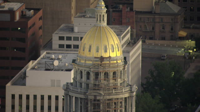 ms td aerial view of gold dome on top of state capitol building / denver, colorado, united states - dome stock videos & royalty-free footage