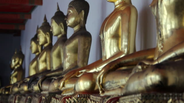 ms tu view of  golden buddha statues / bangkok, thailand - medium group of objects stock videos & royalty-free footage