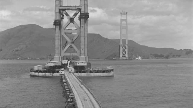 ws view of golden gate bridge under construction - bridge built structure stock videos and b-roll footage