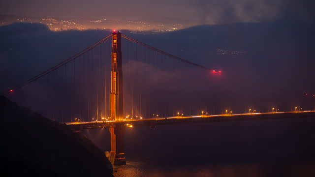 ws t/l view of golden gate bridge with fog rolling in / san francisco, california, united states - san francisco bay stock videos & royalty-free footage
