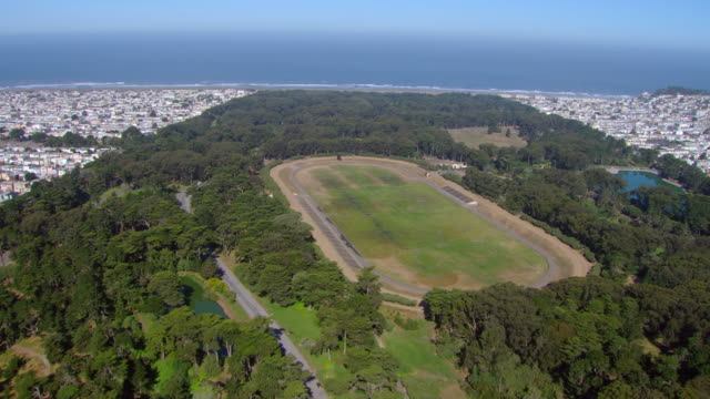 ws aerial view of golden gate park with polo field and coastline / san francisco, california, united states - haight ashbury stock videos & royalty-free footage