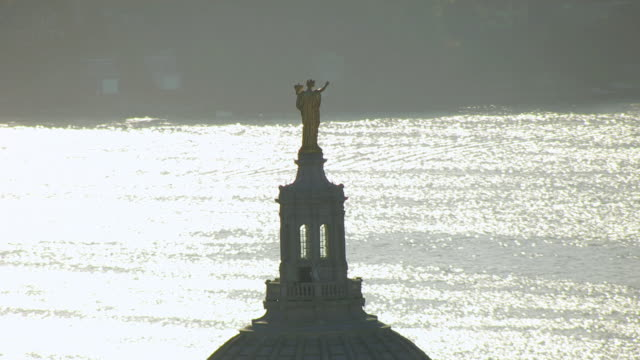 MS AERIAL DS View of Golden Lady statue on top of State Capitol building / Madison, Wisconsin, United States