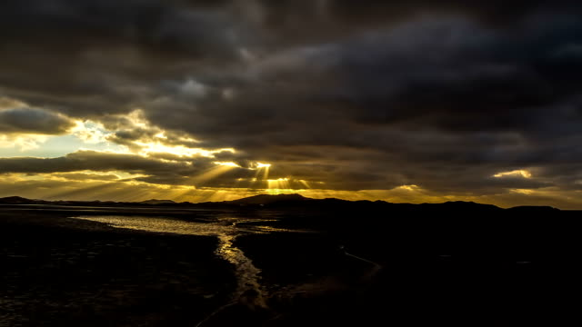 view of golden skyscape at mud flat - mud flat stock videos and b-roll footage