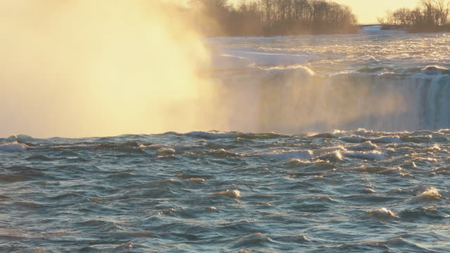 MS View of Golden spray and mist over Horse Shoe falls at sunrise in winter / Niagara Falls, Ontario, Canada