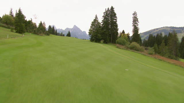 ws aerial view of golf course gstaad-saanenland near saanewald / saanewald, bern, switzerland - green golf course stock videos and b-roll footage
