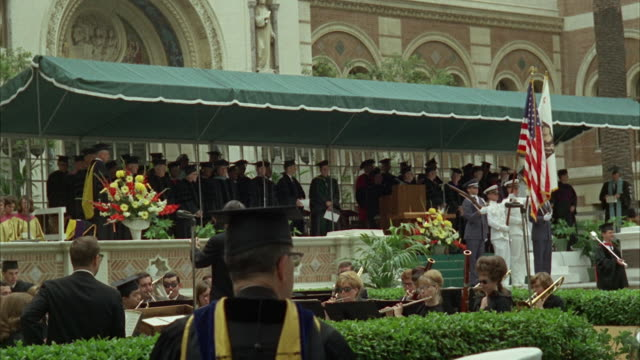 ws view of graduation ceremony in campus - mortarboard stock videos and b-roll footage