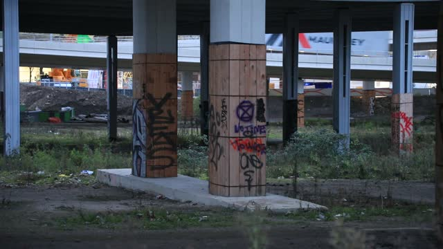 "view of graffiti on the pylons supporting the ring road near the ""tours duo"" skyscrapers by famous architect jean nouvel, a construction site in the... - wilderness stock videos & royalty-free footage"
