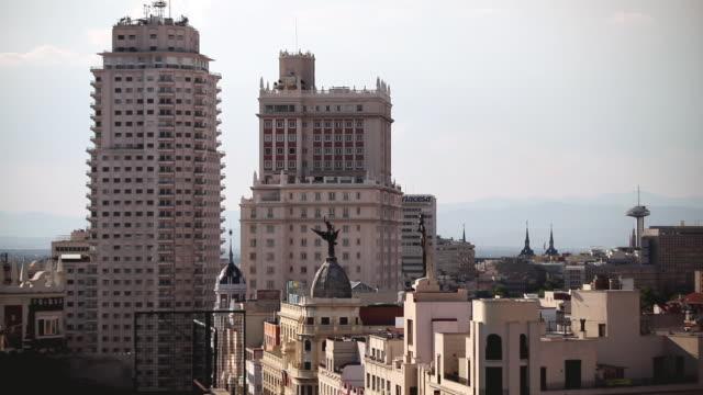 ws view of gran via street / madrid, spain - マドリード グランヴィア通り点の映像素材/bロール