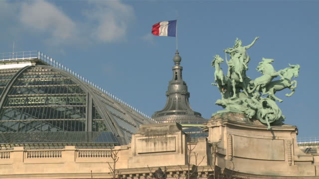 MS View of Grand Palais with French national flag / Paris, Ile de France, France