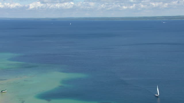 WS AERIAL POV View of Grand Traverse Bay with sail boats / Peninsula Township, Michigan, United States