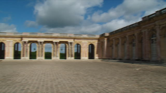 ws pan view of grand trianon exterior / versailles, ile de france, france - chateau de versailles stock videos and b-roll footage