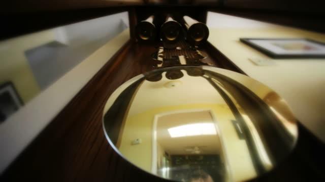 la view of grandfather clock pendulum swinging, includes audio / thousand oaks, california, usa - 大時計点の映像素材/bロール